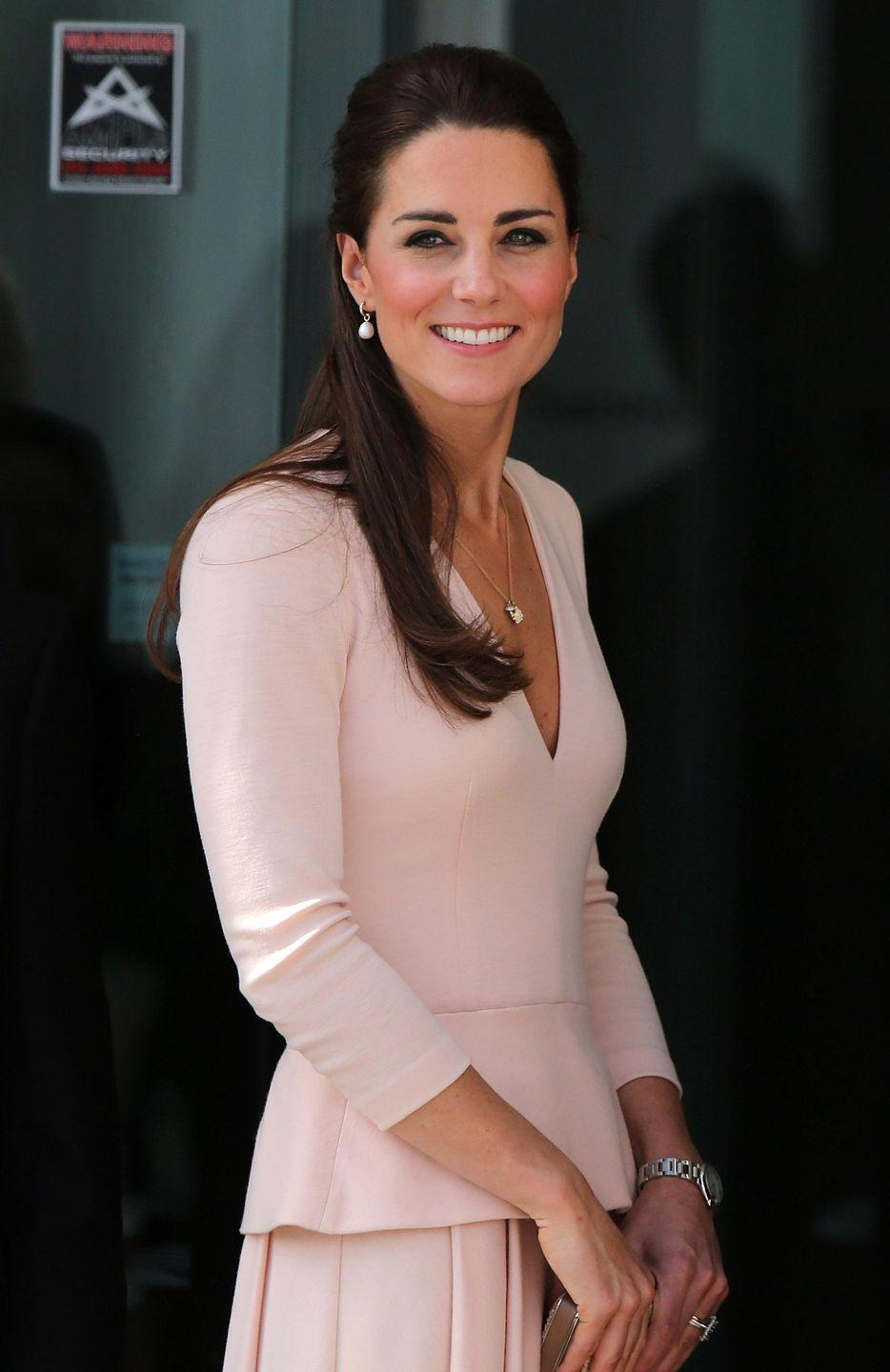 <p>Kate wore this pink Alexander McQueen peplum dress for the first time while touring Australia in 2014. </p>