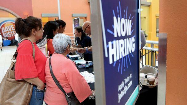 PHOTO: People wait in line to inquire about job openings with Marshalls during a job fair at Dolphin Mall in Miami, Fla., Oct. 1, 2019. (Lynne Sladky/AP, FILE)