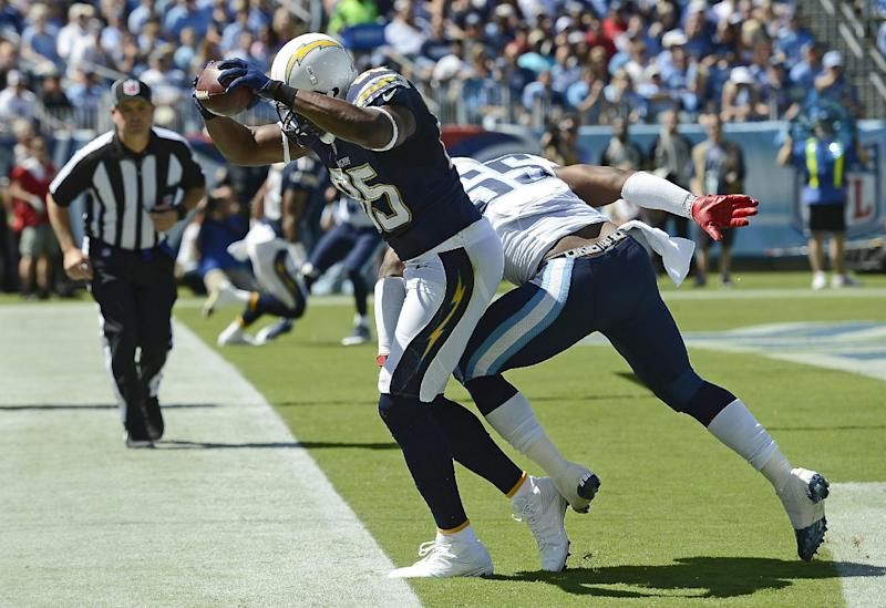 San Diego Chargers tight end Antonio Gates (85) catches a 7-yard touchdown pass as he is defended by Tennessee Titans linebacker Zach Brown (55) in the first quarter of an NFL football game on Sunday, Sept. 22, 2013, in Nashville, Tenn. (AP Photo/Mark Zaleski)