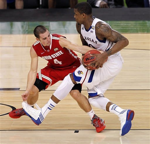 Kansas forward Thomas Robinson drives against Ohio State guard Aaron Craft (4) during the second half of an NCAA Final Four semifinal college basketball tournament game Saturday, March 31, 2012, in New Orleans. (AP Photo/Bill Haber)