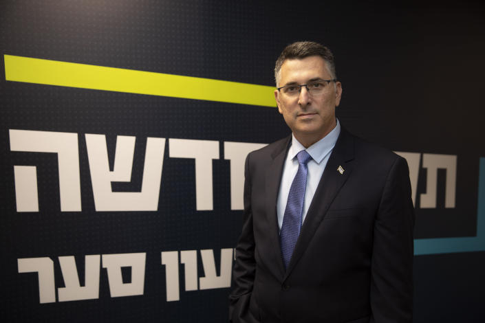 """Israeli politician Gideon Saar poses for a photo at the party headquarters in Tel Aviv, Israel, Thursday, Jan. 14, 2021. Saar is promising """"new hope"""" for voters ahead of March elections, and a different approach to relations with the United States after the four-year lovefest between Prime Minister Benjamin Netanyahu and President Donald Trump. (AP Photo/Sebastian Scheiner)"""