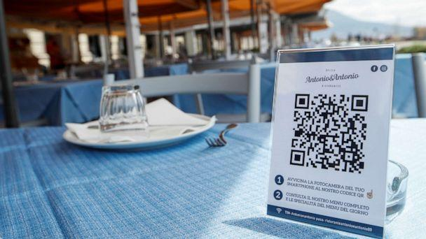 PHOTO: A view shows a QR code for the menu of the restaurant before its reopening on the waterfront in Naples, as Italy eases some of the lockdown measures put in place during the COVID-19 outbreak, in Naples, Italy, May 21, 2020. (Ciro De Luca/Reuters)