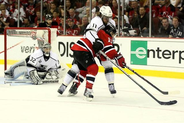 NEWARK, NJ - JUNE 09: Stephen Gionta #11 of the New Jersey Devils goes for a loose puck against Anze Kopitar #11 of the Los Angeles Kings in front of Jonathan Quick #32 during Game Five of the 2012 NHL Stanley Cup Final at the Prudential Center on June 9, 2012 in Newark, New Jersey. (Photo by Elsa/Getty Images)