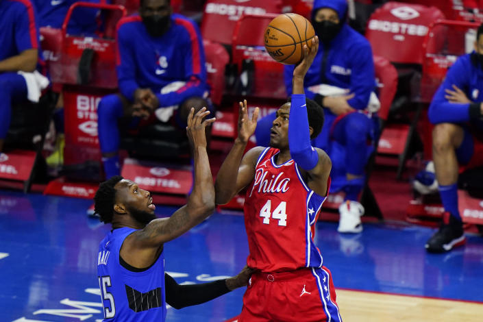 Philadelphia 76ers' Paul Reed, right, goes up for a shot against Orlando Magic's Donta Hall during the second half of an NBA basketball game, Friday, May 14, 2021, in Philadelphia. (AP Photo/Matt Slocum)