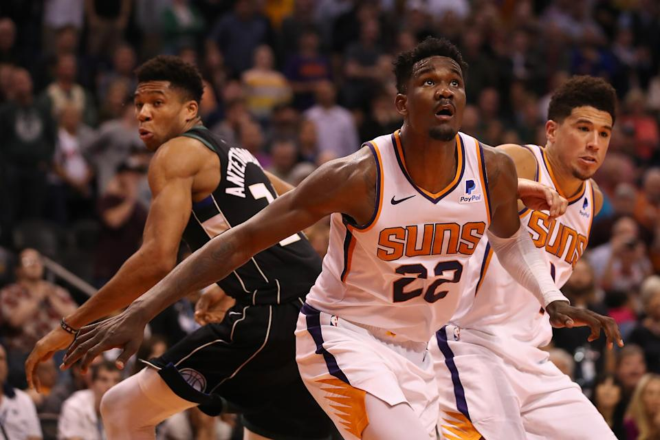Giannis Antetokounmpo, Deandre Ayton and Devin Booker are among a generation of bright young NBA stars. (Christian Petersen/Getty Images)