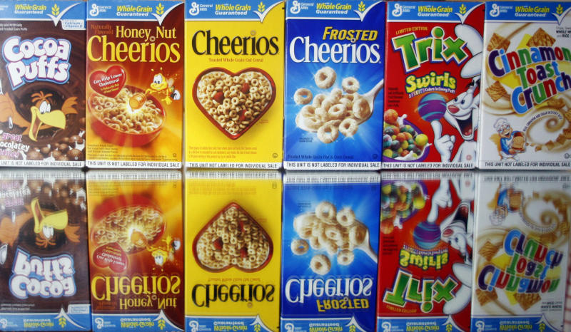 FILE - This March 22, 2011 file photo shows boxes of General Mills cereals in Portland, Ore. General Mills on Monday, June 22, 2015 said it is dropping artificial colors and flavors from its cereals, the latest company to respond to a growing desire for food made with ingredients people see as natural. (AP Photo/Rick Bowmer, File)