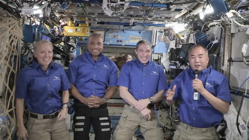From left, NASA's Shannon Walker, Victor Glover and Michael Hopkins, and Japan's Soichi Noguchi hold a news conference aboard the International Space Station on Monday, April 26, 2021. They are winding up a six-month mission, after their replacements arrived Saturday on their own SpaceX capsule. (NASA via AP)