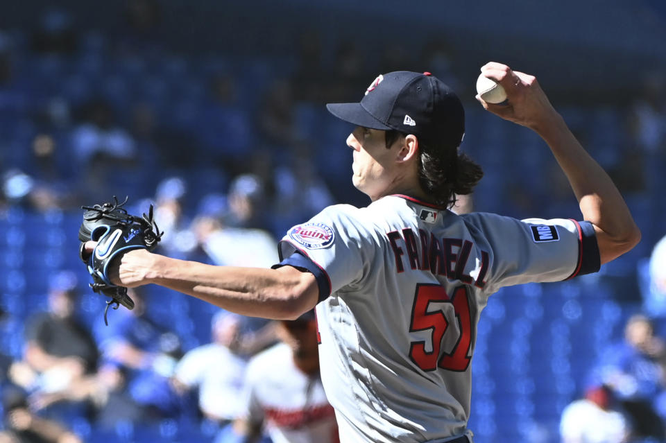Minnesota Twins starting pitcher Luke Farrell pitches in the first inning of a baseball game against the Toronto Blue Jays in Toronto on Sunday, Sept. 19, 2021. (Jon Blacker/The Canadian Press via AP)