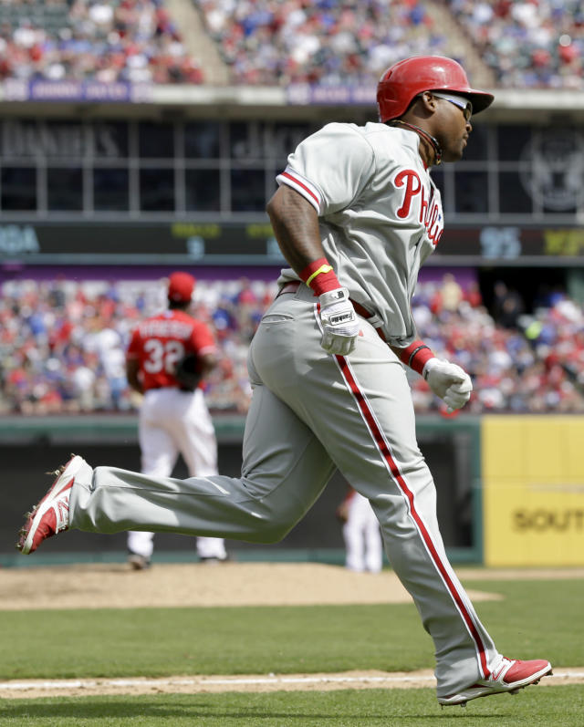 Philadelphia Phillies' Marlon Byrd rounds the bases after hitting a home run off Texas Rangers relief pitcher Pedro Figueroa during the sixth inning of an opening day baseball game at Globe Life Park, Monday, March 31, 2014, in Arlington, Texas. (AP Photo/Tony Gutierrez)
