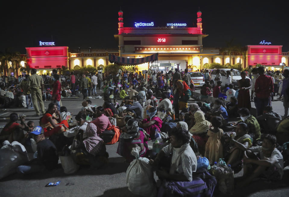 Migrant workers line up to board trains to their home states, at Hyderabad Railway Station in Hyderabad, India, Saturday, May 23, 2020. India's lockdown was imposed on March 25 and has been extended several times. On May 4, India eased lockdown rules and allowed migrant workers to travel back to their homes, a decision that has resulted in millions of people being on the move for the last two weeks. (AP Photo/Mahesh Kumar A.)