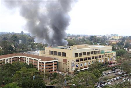 Smoke rises from the Westgate shopping centre after explosions at the mall in Nairobi September 23, 2013. REUTERS/Noor Khamis