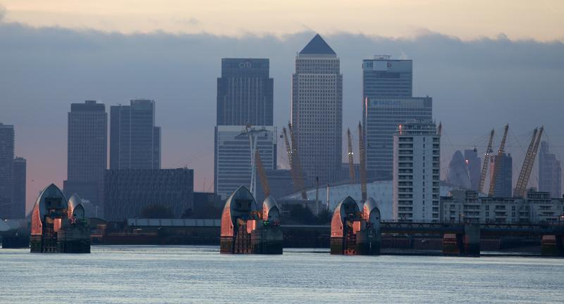 London's financial district is seen behind the Thames Barrier late afternoon
