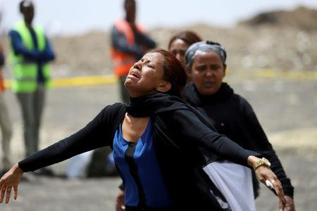 A relative mourns at the scene of the Ethiopian Airlines Flight ET 302 plane crash, near the town Bishoftu, near Addis Ababa, Ethiopia March 14, 2019. REUTERS/Tiksa Negeri