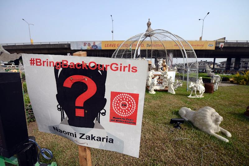 A sign bearing the name of one of the Chibok schoolgirls kidnapped by Boko Haram, Naomi Zakaria, hangs close to Christmas decorations on December 17, 2014, at Ikoyi, in Lagos (AFP Photo/Pius Utomi Ekpei)
