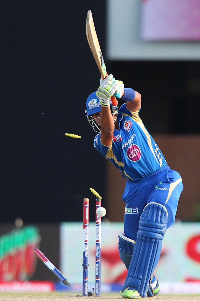 Aditya Tare is bowled by Sandeep Sharma during match 69 of the Pepsi Indian Premier League between The Kings XI Punjab and the Mumbai Indians held at the HPCA Stadium in Dharamsala, Himachal Pradesh, India on the on the 18th May 2013. (BCCI)