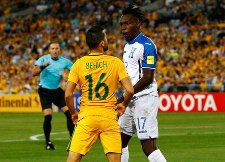 Soccer Football - 2018 World Cup Qualifications - Australia vs Honduras - ANZ Stadium, Sydney, Australia - November 15, 2017 Australia's Aziz Behich clashes with Honduras' Alberth Elis REUTERS/David Gray