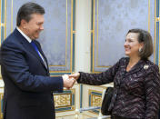FILE - In this Feb. 6, 2014, file photo, Ukraine's President Viktor Yanukovych, left, greets U.S. Assistant Secretary for European and Eurasian Affairs Victoria Nuland, in Kyiv, Ukraine, Thursday, Feb. 6, 2014. When Secretary of State Antony Blinken travels to Ukraine he'll be carrying a tough anti-graft message and strong U.S. backing for the country's response to Russian aggression. He'll also be bringing along a familiar face in the Washington-Moscow tug-of-war over Ukraine: Victoria Nuland. The mere presence in Kyiv of Nuland, now the No. 3 State Department official, is likely to irritate Russia. (AP Photo/Mykhailo Markiv, Pool, File)