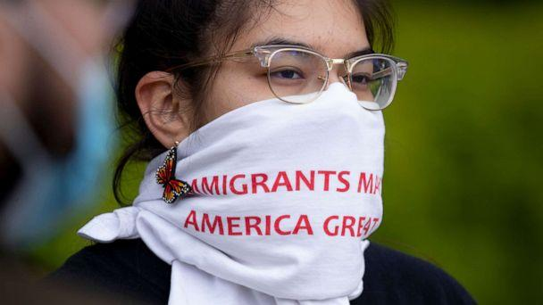PHOTO: A participant wears a covering on her face that reads 'Immigrants Make America Great,' during a demonstration held by immigration advocates and 'DREAMers' outside the U.S. Supreme Court in Washington, April 27, 2020. (Michael Reynolds/EPA via Shutterstock)