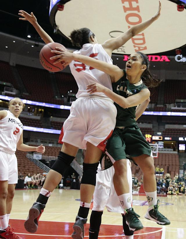 Cal Poly's Ariana Elegado, right, passes the ball behind Cal State Northridge's Jasmine Johnson during the first half of an NCAA college basketball game in the final of the Big West Conference tournament, on Saturday, March 15, 2014, in Anaheim, Calif. (AP Photo/Jae C. Hong)