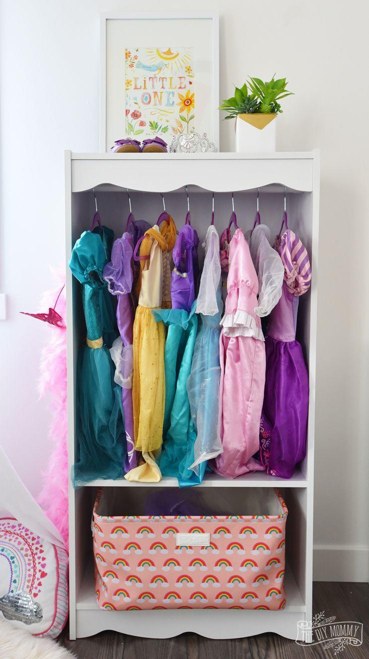 """<p>Mimic mommy's built-in closet by turning an armoire or shelving unit into a closet just for dress-up clothes and accessories.</p><p><strong>See more at </strong><strong><a href=""""https://thediymommy.com/diy-dress-up-storage-bookcase-hack/"""" rel=""""nofollow noopener"""" target=""""_blank"""" data-ylk=""""slk:The DIY Mommy"""" class=""""link rapid-noclick-resp"""">The DIY Mommy</a>.</strong></p><p><strong><a class=""""link rapid-noclick-resp"""" href=""""https://www.amazon.com/Milliard-Storage-Organizer-Furniture-Dramatic/dp/B07K4CH6ZN/?tag=syn-yahoo-20&ascsubtag=%5Bartid%7C10063.g.36014277%5Bsrc%7Cyahoo-us"""" rel=""""nofollow noopener"""" target=""""_blank"""" data-ylk=""""slk:SHOP DRESS-UP STORAGE"""">SHOP DRESS-UP STORAGE</a><br></strong></p>"""