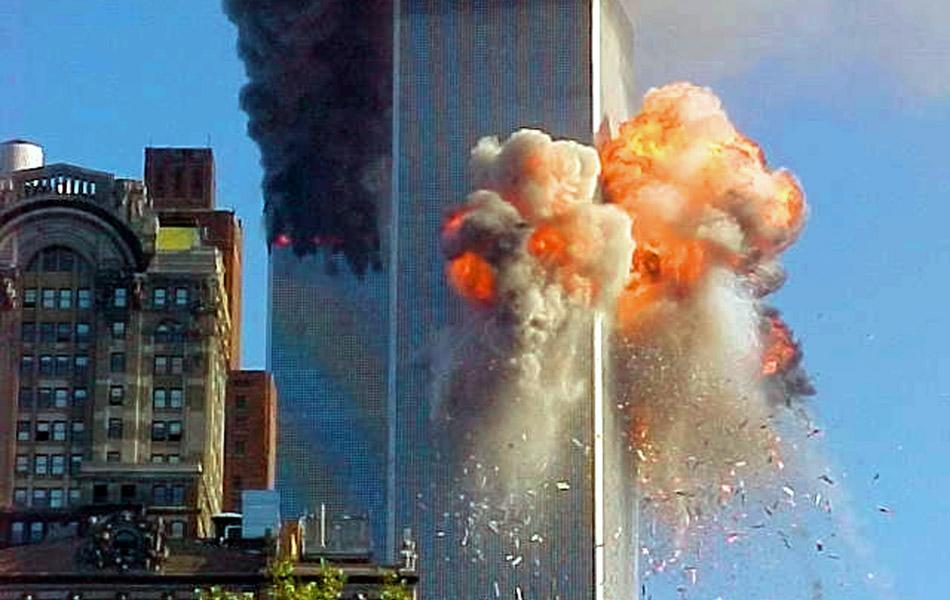 LEAVE INACTIVE - United flight 175 flies directly into World Trade Center tower 2 during a terrorist attack. (Photo by Carmen Taylor/WireImage) *** Local Caption ***