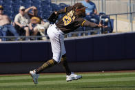 RETRANMISSION TO CORRECT LOCATION TO PEORIA - San Diego Padres shortstop Fernando Tatis Jr. reaches for a ground ball hit for a single by Oakland Athletics's Kai'ai Tom in the third inning of a spring training baseball game Thursday, March 18, 2021, in Peoria, Ariz. (AP Photo/Sue Ogrocki)