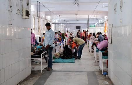 Relatives visit child patients who suffer from acute encephalitis syndrome in a hospital ward in Muzaffarpur