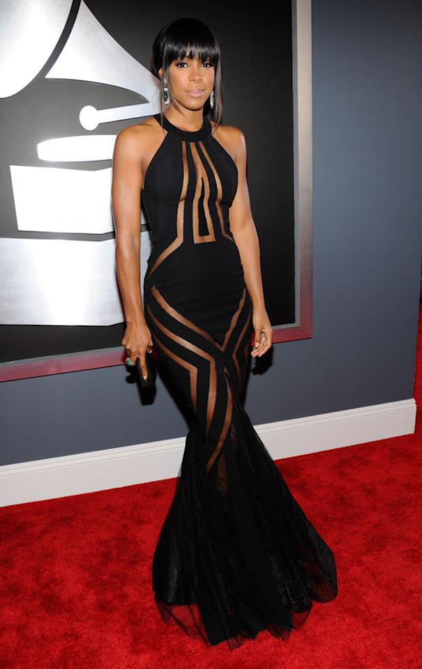 The Grammys: Best and Worst Dressed: Kelly Rowland looked frankly amazing in this gorge optical illusion dress. Copyright: [getty]