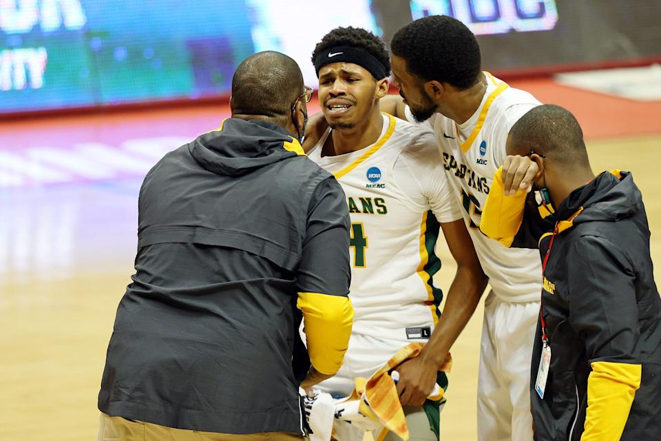Norfolk State guard Devante Carter, center, reacts with coach Robert Jones, left, after their win against Appalachian State in the First Four of the 2021 NCAA Tournament at Simon Skjodt Assembly Hall.