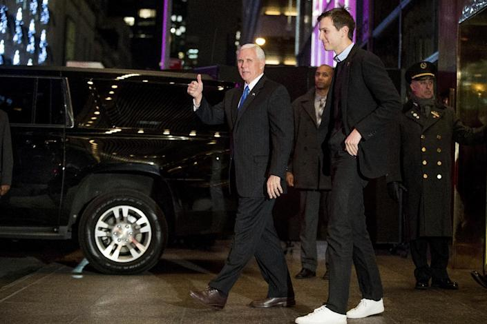 FILE - In this Dec. 7, 2016 file photo, Vice President-elect Mike Pence, left, and Jared Kushner, second from right, depart from Trump Tower, in New York. Kushner, President-elect Donald Trump's son-in-law and one of his closest advisers, is taking steps to distance himself from his sprawling New York real estate business in what is the clearest sign yet he is planning to take a position in his father-in-law's administration. Kushner, who is married to Trump's daughter Ivanka, must clear a series of hurdles before he takes any post in Washington. (AP Photo/Andrew Harnik)
