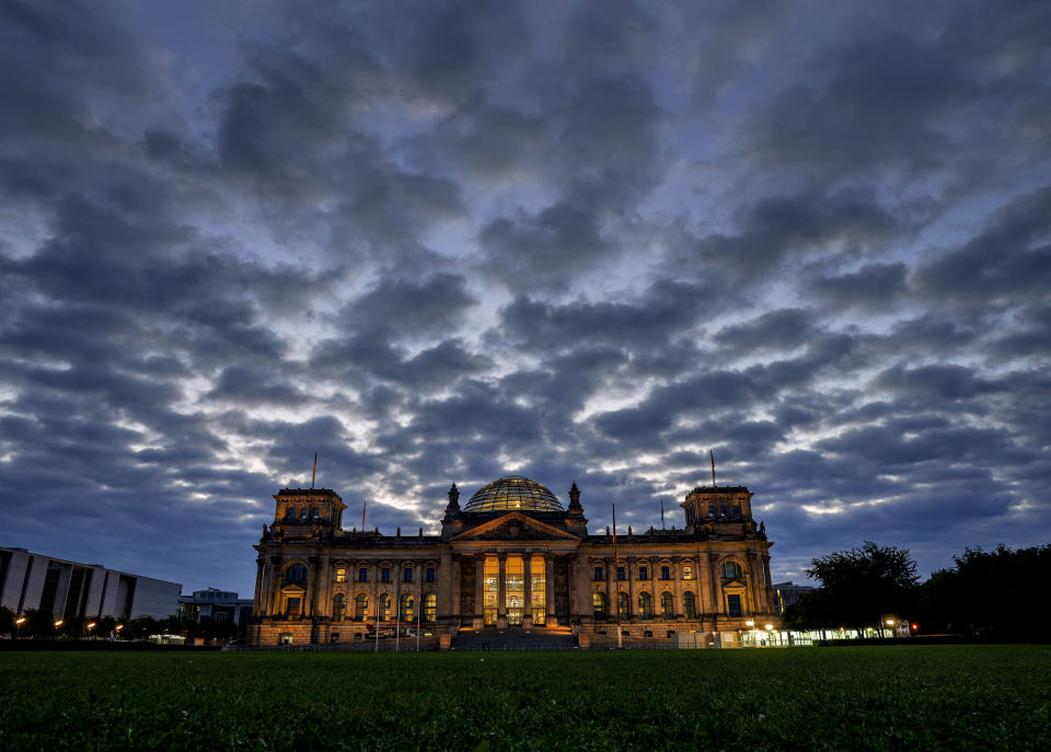 Clouds drift over the Reichstag building with the German parliament in Berlin, Germany, Sunday, Sept. 26, 2021. German elections are held on Sunday. (AP Photo/Michael Probst)