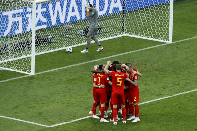 Belgium players celebrate after Romelo Lukaku scored their side's second goal as Panama goalkeeper Jaime Penedo, top, picks the ball inside the goal during the group G match between Belgium and Panama at the 2018 soccer World Cup in the Fisht Stadium in Sochi, Russia, Monday, June 18, 2018. (AP Photo/Victor R. Caivano)