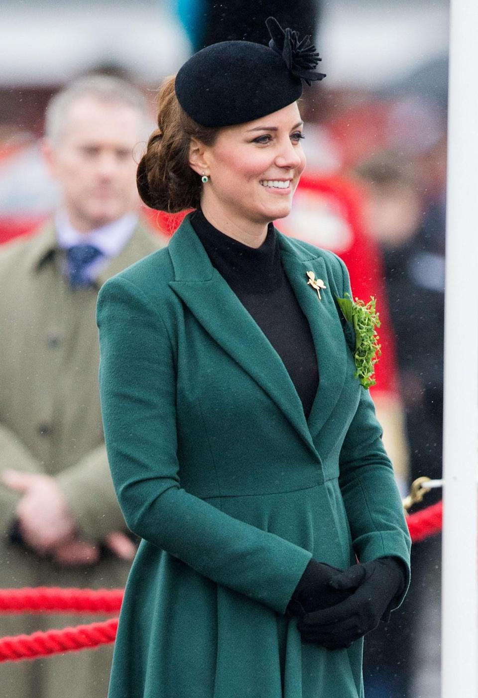 <p>The late Queen Mother's gold shamrock brooch completed the look. <em>[Photo: PA]</em> </p>