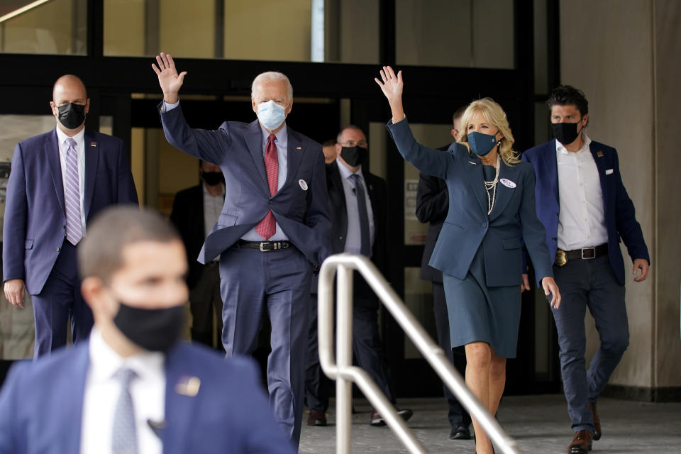 Democratic presidential candidate former Vice President Joe Biden and his wife Jill Biden wave after they voted at the Carvel State Office Building, Wednesday, Oct. 28, 2020, in Wilmington, Del. (AP Photo/Andrew Harnik)