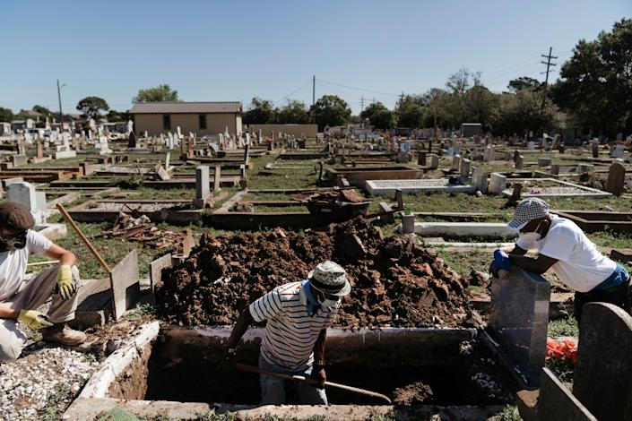 Cemetery workers prepare for upcoming burials in New Orleans on April 30, 2020. (Annie Flanagan/The New York Times)
