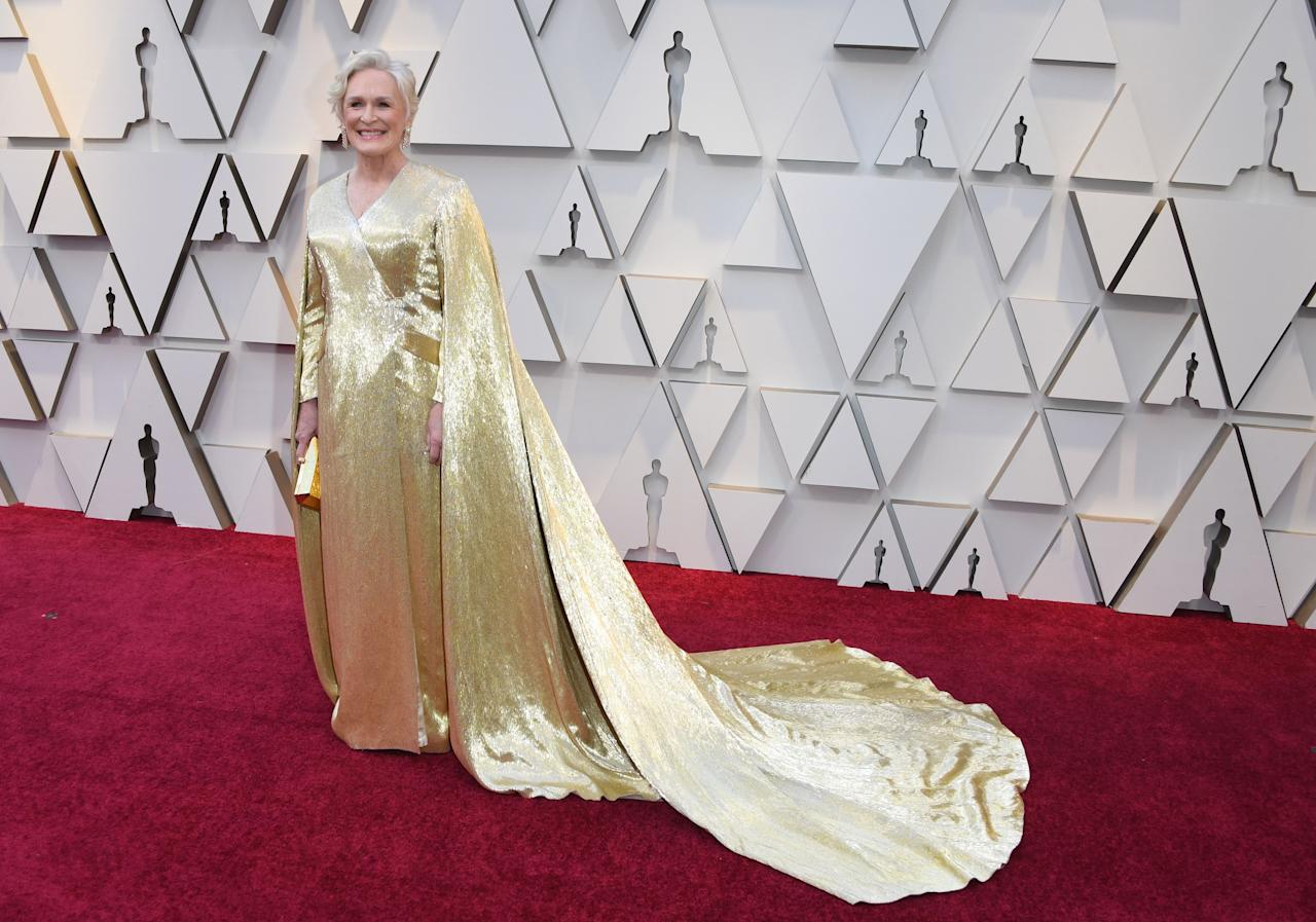 "<p>The Best Actress nominee and star of ""The Wife"" looked regal in gold as she arrived at the Oscars. (Image via Getty Images) </p>"