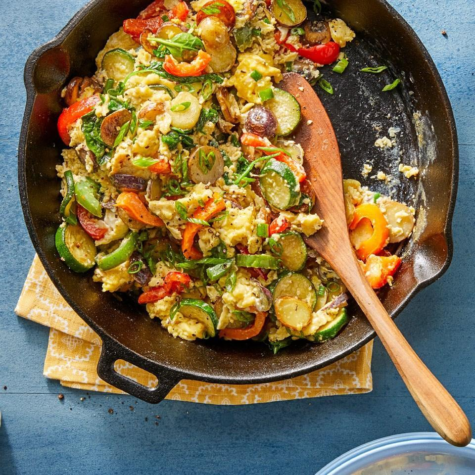 <p>Don't toss out those almost-past-their-prime vegetables and fresh herbs. Toss them into this skillet egg scramble for a quick vegetarian meal. Nearly any vegetable will work in this easy skillet recipe, so choose your favorites or use what you have on hand.</p>
