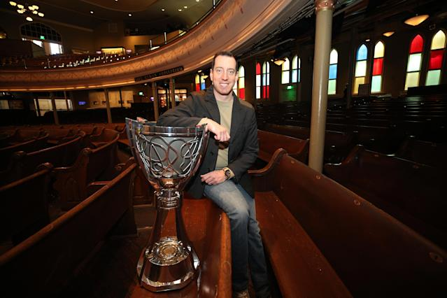 "<a class=""link rapid-noclick-resp"" href=""/nascar/sprint/drivers/947/"" data-ylk=""slk:Kyle Busch"">Kyle Busch</a> poses with the Cup Series championship trophy in December after he won his second Cup Series title. (Photo by Chris Graythen/Getty Images)"