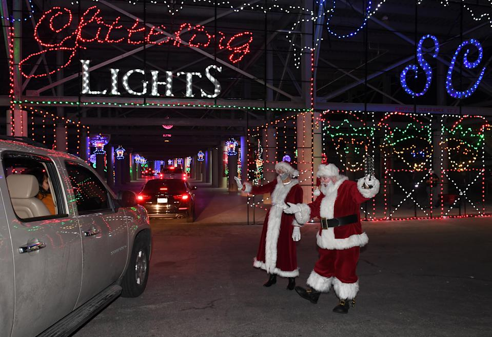 Viewing Christmas lights at a drive-through display — such as this year's Glittering Lights at the Las Vegas Motor Speedway, is a generally safe holiday activity this year. (Photo: Ethan Miller/Getty Images)