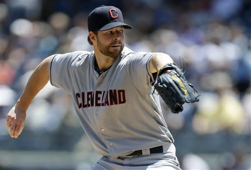 Cleveland Indians starting pitcher Corey Kluber delivers in the first inning of a baseball game against the New York Yankees at Yankee Stadium in New York, Wednesday, June 5, 2013. (AP Photo/Kathy Willens)