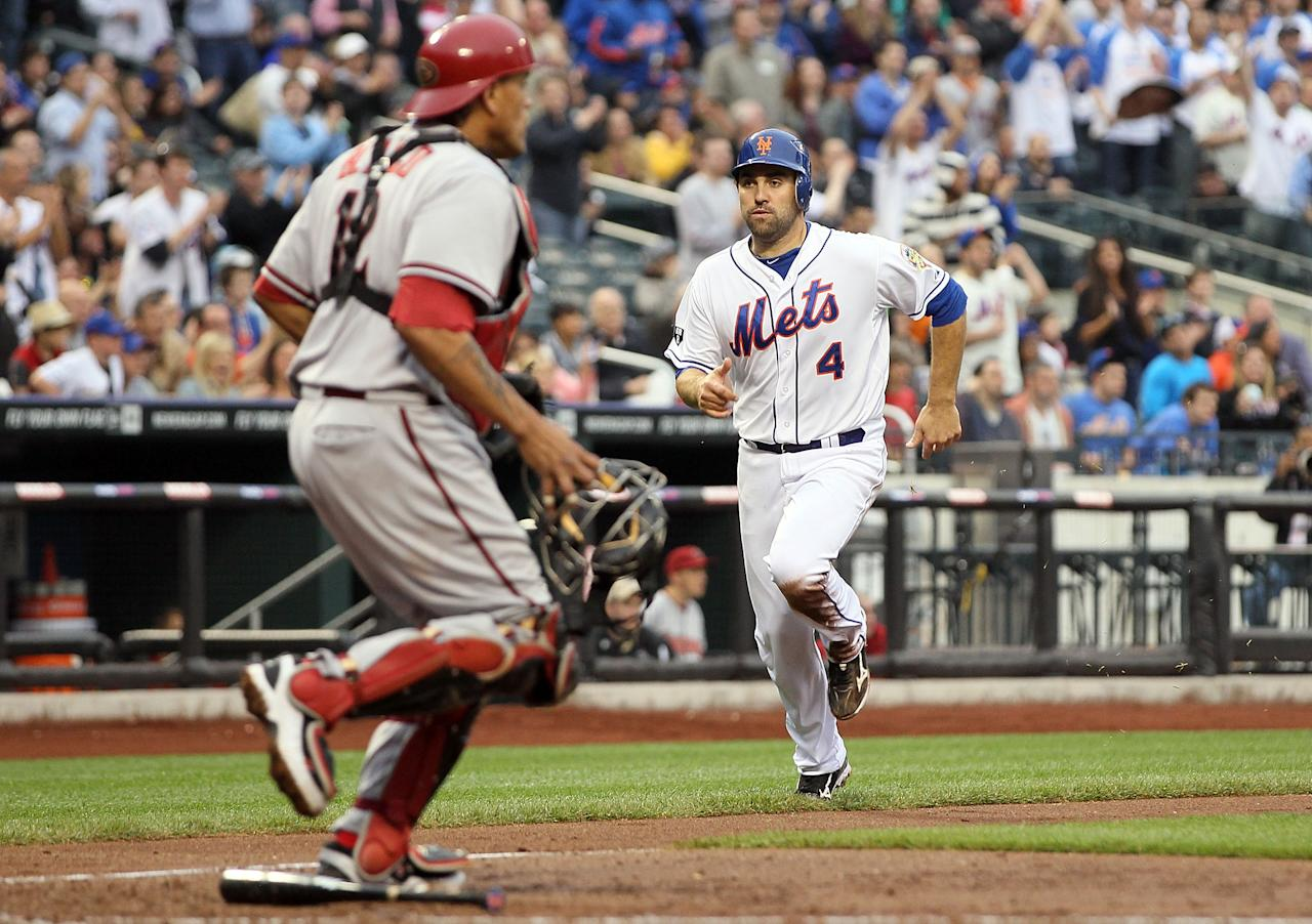 NEW YORK, NY - MAY 05:  Mike Nickeas #4 of the New York Mets scores his teams fourth run in the fourth inning past Henry Blanco #12 of the Arizona Diamondbacks at Citi Field on May 5, 2012 in the Flushing neighborhood of the Queens borough of New York City.  The Mets defeated the Diamondbacks 4-3.(Photo by Jim McIsaac/Getty Images)