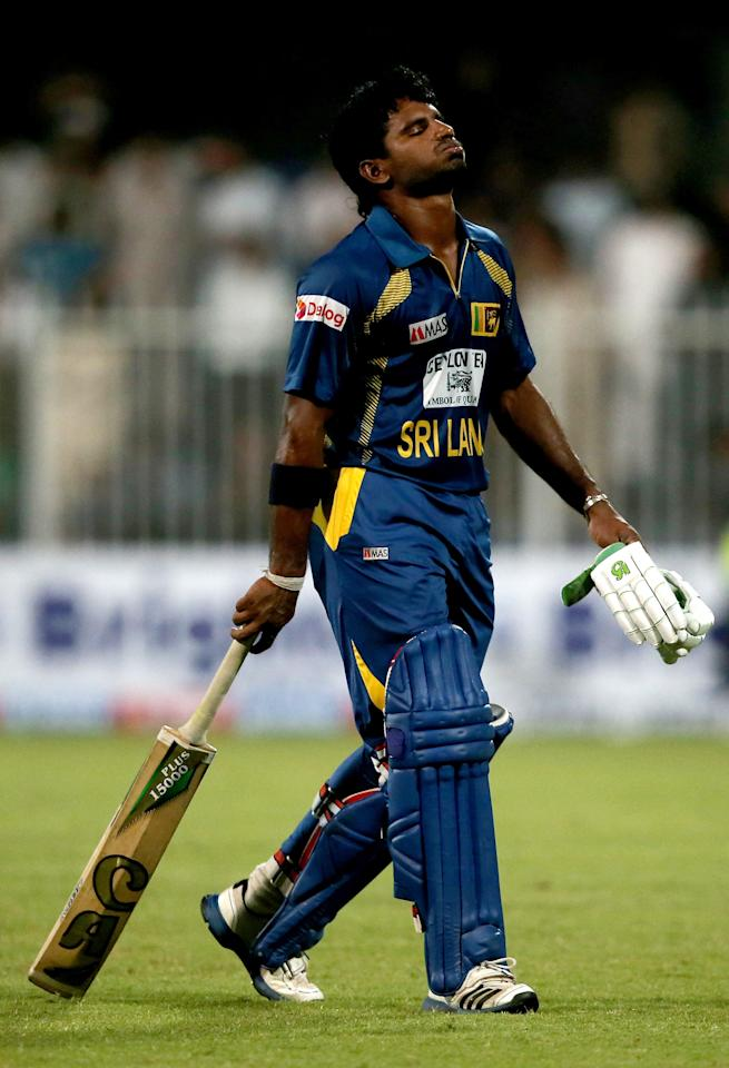 SHARJAH, UNITED ARAB EMIRATES - DECEMBER 18:  Kusal Janith Perera of Sri Lanka reacts after being dismissed during the first One-Day International (ODI ) match between Sri Lanka and Pakistan at the Sharjah Cricket Stadium on December 18, 2013 in Sharjah, United Arab Emirates.  (Photo by Francois Nel/Getty Images)