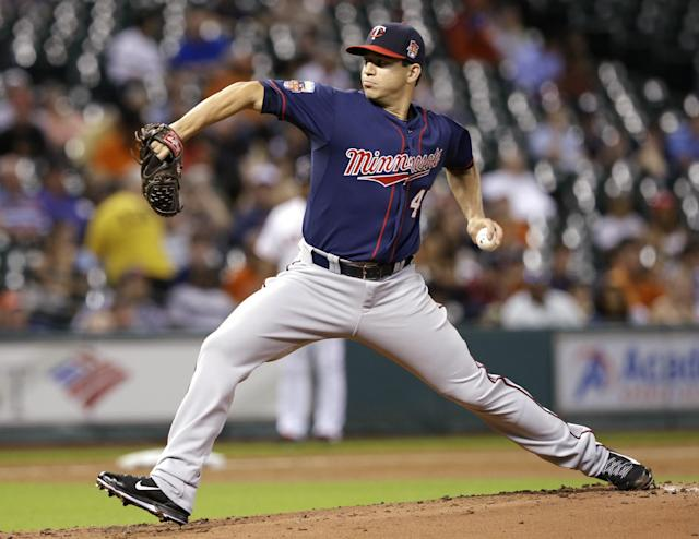 In his debut with the Minnesota Twins Tommy Milone delivers a pitch against the Houston Astros in the first inning of a baseball game Monday, Aug. 11, 2014, in Houston. (AP Photo/Pat Sullivan)