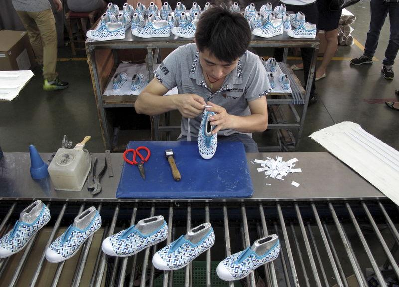 Employee works at a Shuangwei factory in Putian