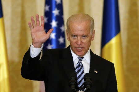 U.S. Vice President Joe Biden waves at the end of a speech to students, young activists and officials in Bucharest