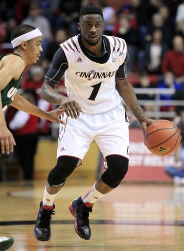 Cincinnati guard Cashmere Wright (1) brings the ball upcourt against Mississippi Valley State guard Darryl Marshall in the first half of an NCAA college basketball game, Tuesday, Nov. 13, 2012, in Cincinnati. (AP Photo/Al Behrman)
