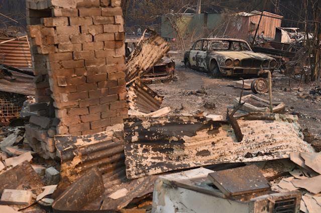 "A vintage Jaguar car sits in ruins after a bushfire destroyed a property in Old Bar, 350km north of Sydney on November 10, 2019. Firefighters in eastern Australia were on November 10, 2019 assessing damage from ferocious bushfires that have devastated communities and rushing to prepare for ""bad, if not worse"" conditions expected to flare in the coming days. (Photo by PETER PARKS/AFP via Getty Images)"