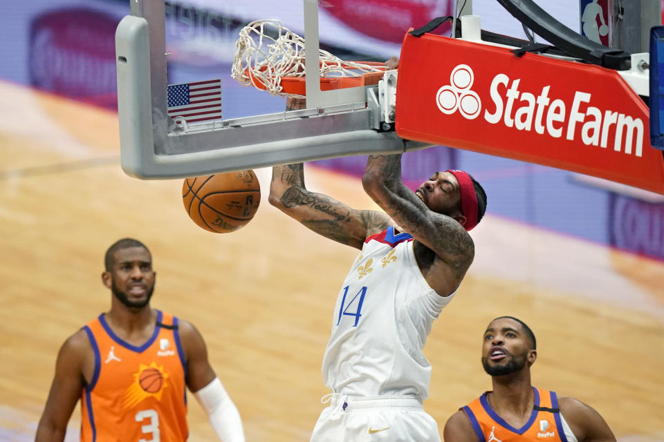 New Orleans Pelicans forward Brandon Ingram (14) dunks during the first half of the team's NBA basketball game against the Phoenix Suns in New Orleans, Friday, Feb. 19, 2021. (AP Photo/Gerald Herbert)