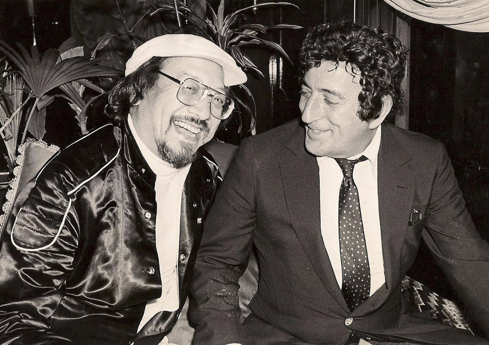 """In this undated photo released by Radio Television Hong Kong, Hong Kong DJ, Ray Cordeiro, left, also known as Uncle Ray, interviews American singer Tony Bennett in Hong Kong. After more than seven decades in radio, the 96-year-old Hong Kong DJ bid farewell to his listeners Saturday, May 15, 2021 with """"Time to Say Goodbye,"""" sung by Sarah Brightman and Andrea Bocelli. (Radio Television Hong Kong via AP)"""