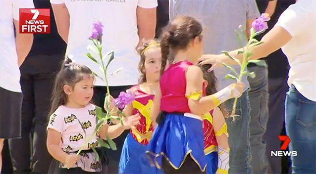 Kids dressed as superheroes at Zane's funeral. Source: 7 News